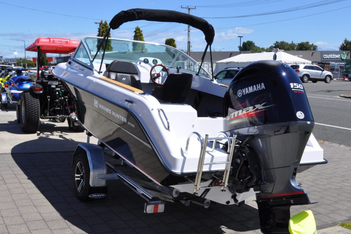 Exiting the water is easy with our deluxe boarding ladder with transom mounted handles | Haines Hunter