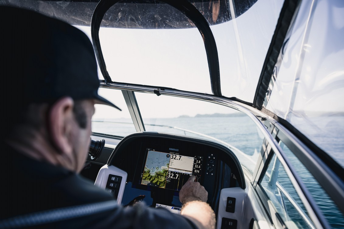 Simrad touch-screen electronics inset into the dash. Gauges and switches within easy reach. | Haines Hunter